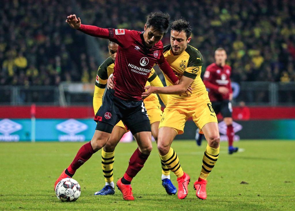 NUREMBERG, Feb. 19, 2019 - Nuremberg's Yuya Kubo (L) vies with Dortmund's Thomas Delaney during a German Bundesliga match between 1. FC Nuremberg and Borussia Dortmund in Nuremberg, Germany, Feb. 18, ...