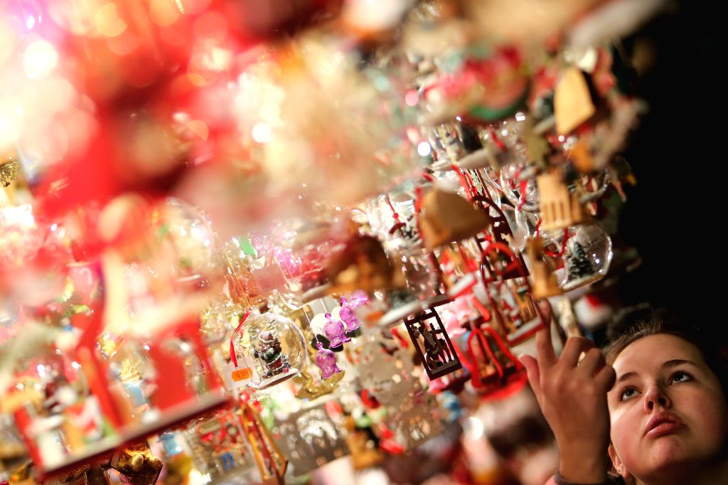 Nuremberg (Germany): A visitor views Christmas decorations at the Nuremberg Christmas Market in Nuremberg, Germany, Nov. 28, 2014. The Nuremberg Christmas Market, one of the oldest in Germany, opened