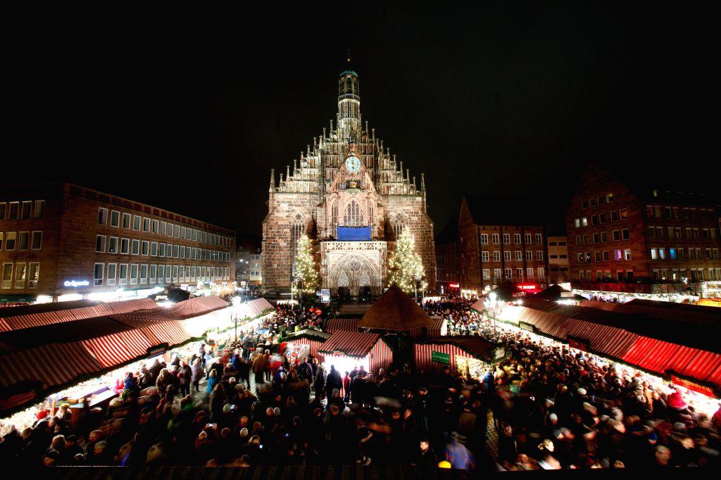Nuremberg (Germany): This long exposure photo shows people visiting the Nuremberg Christmas Market in Nuremberg, Germany, Nov. 28, 2014. The Nuremberg Christmas Market, one of the oldest in Germany, .