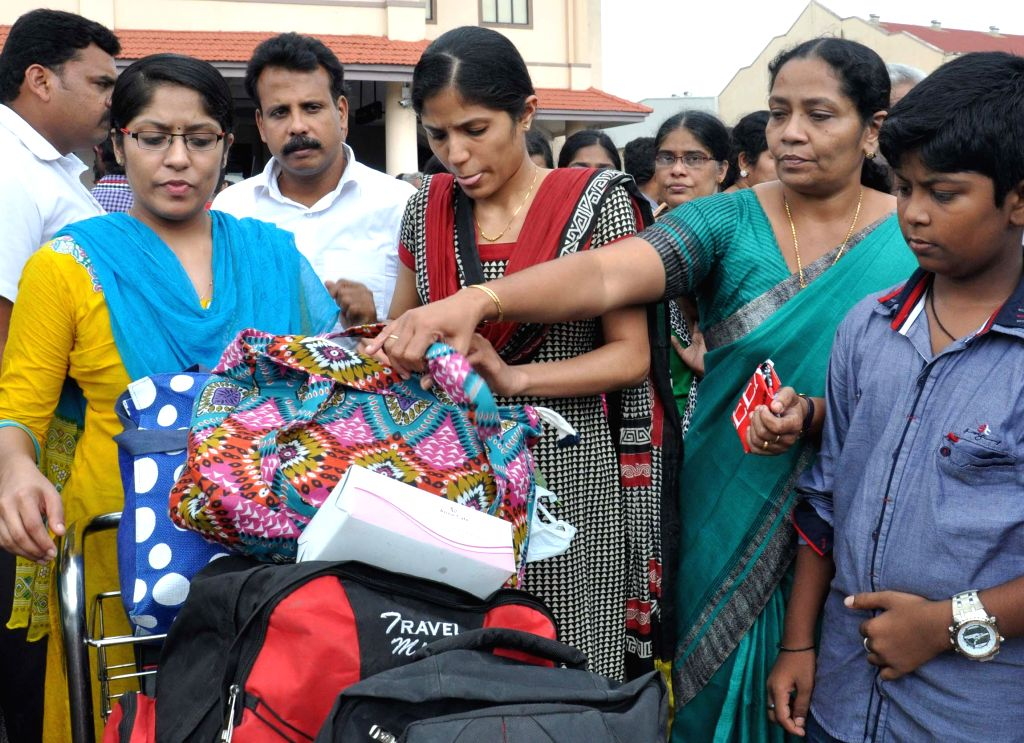 Nurses returns from Iraq by a special flight at the Cochin International Airport in Kochi, Kerala on July 5, 2014.