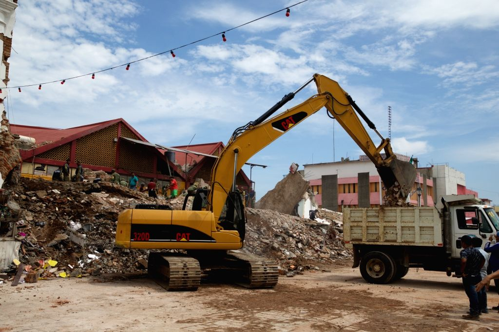 OAXACA (MEXICO), Sept. 9, 2017 An excavator removes debris from collapsed building after an earthquake in Oaxaca state, Mexico, on Sept. 8, 2017. A powerful earthquake measuring 8.2 on ...