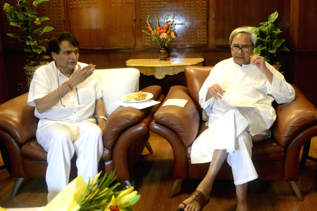 Odisha Chief Minister Naveen Patnaik calls on Union Railway Minister Suresh Prabhu at Rail Bhawan in New Delhi on Oct 10, 2016. - Naveen Patnaik and Suresh Prabhu