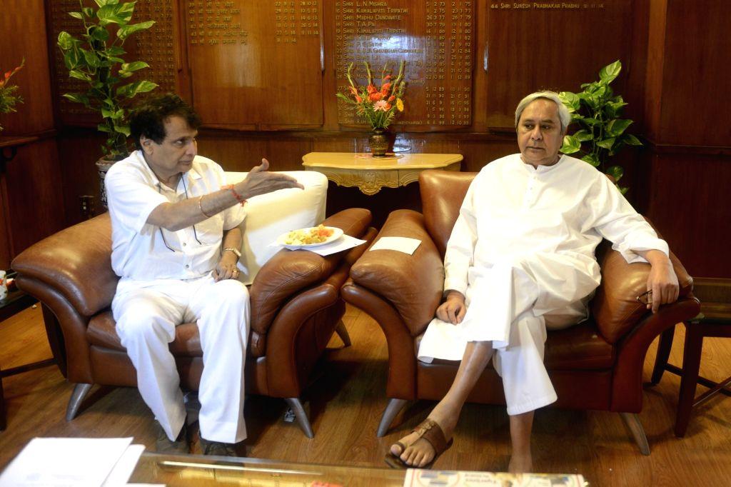 Odisha Chief Minister Naveen Patnaik calls on Union Railway Minister Suresh Prabhu at Rail Bhawan in New Delhi on Oct 10, 2016. - Naveen Patnaik and Suresh Prabhu
