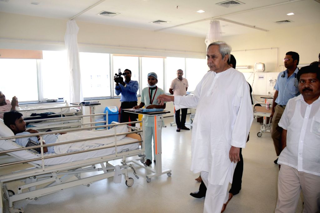 Odisha Chief Minister Naveen Patnaik visits Institute of Medical Sciences and SUM Hospital where a fire broke out killing 22 people in Bhubaneswar on Oct 18, 2016. - Naveen Patnaik
