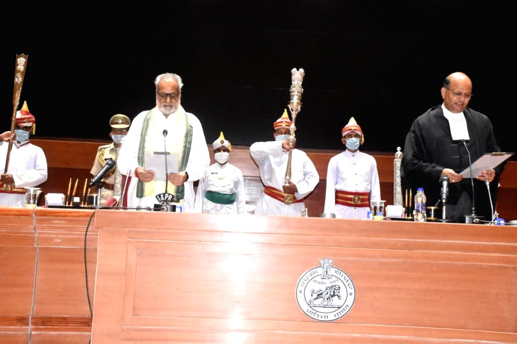 Odisha Governor Ganeshi Lal administers the oath of office to Justice Mohammad Rafiq as the new Chief Justice of the Orissa High Court in Bhubaneswar amid the nationwide lockdown imposed to mitigate ...