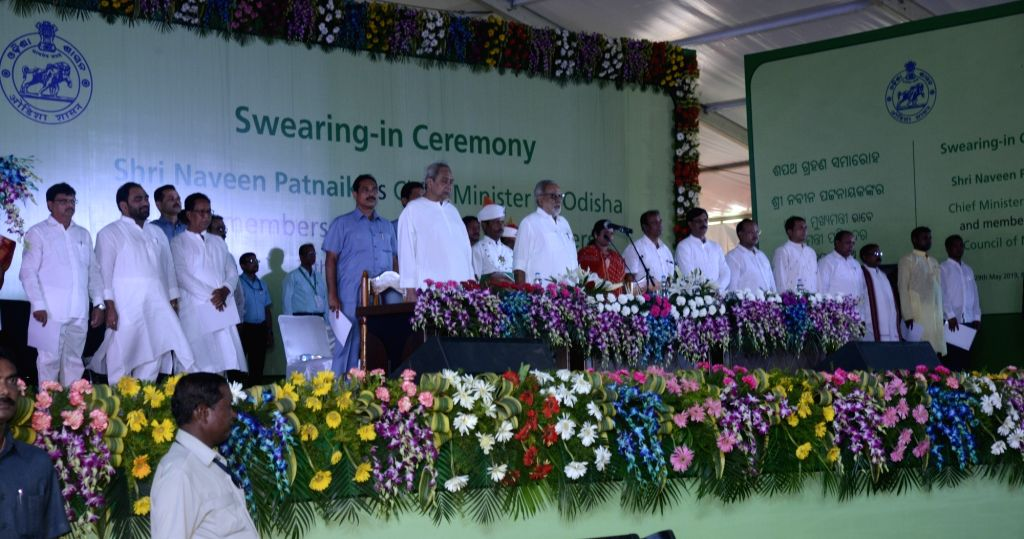 Odisha Governor Ganeshi Lal with the newly sworn-in state Chief Minister Naveen Patnaik and cabinet ministers, at a swearing-in ceremony in Bhubaneswar, on May 29, 2019. Patnaik was ... - Naveen Patnaik