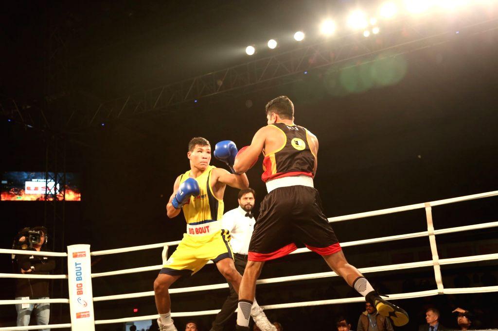 Odisha Warriors' Jakhongir Rakhmonov (yellow) in action against Bengaluru Brawlers' Dinesh Dagar during the Big Bout Indian Boxing League at Delhi's Indira Gandhi Indoor Stadium on Dec 7, ...