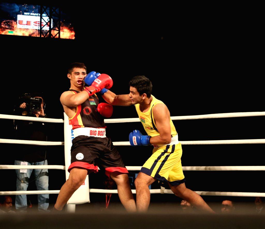 Odisha Warriors' Naman Tanwar (yellow) in action during the Big Bout Indian Boxing League at Delhi's Indira Gandhi Indoor Stadium on Dec 7, 2019.