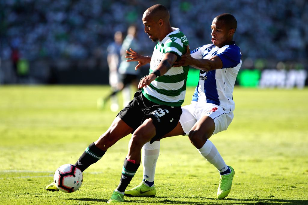 OEIRAS, May 26, 2019 - Porto's Yacine Brahimi (R) vies with Sporting's Bruno Gaspar during the Portugal Cup Final match between Sporting CP and FC Porto at Jamor stadium in Oreiras, Portugal, May 25, ...