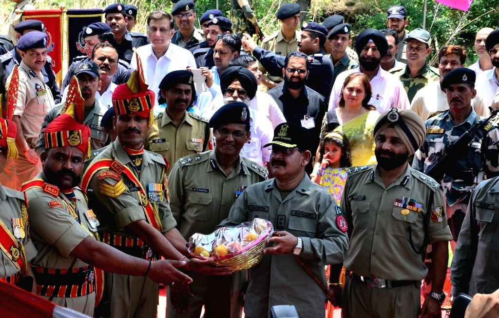Officers of BSF and Pakistan Rangers during Baba Chamliyal mela at Jammu and Kashmir's Samba district near International Border with Pakistan on June 23, 2016.