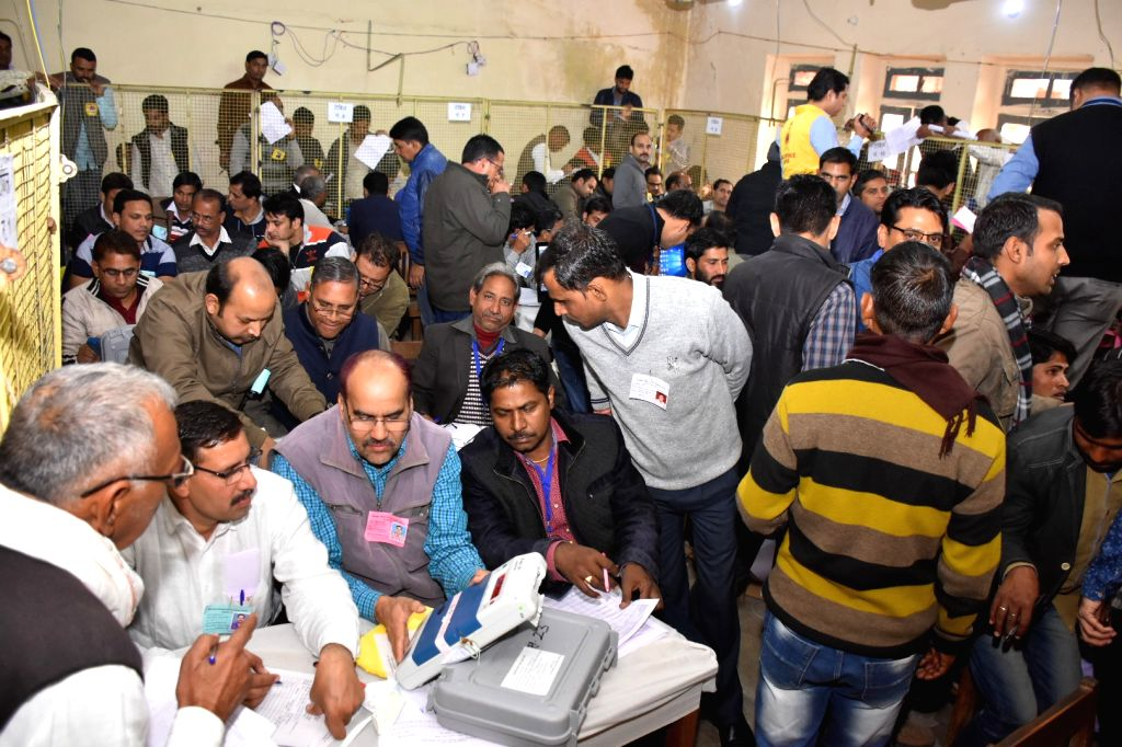 Officials busy counting votes cast during the recently concluded Rajasthan Assembly polls at a counting centre in Jaipur on Dec 11, 2018. The results will seal the fate of 2,274 candidates ...