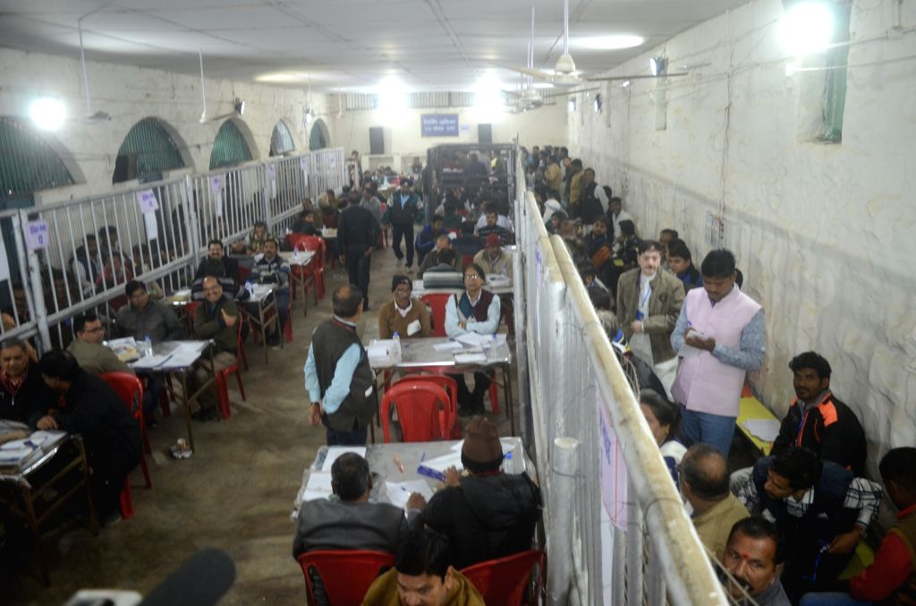 Officials busy counting votes cast during the recently concluded Madhya Pradesh Assembly polls at a counting centre in Bhopal on Dec 11, 2018. Results will be declared in a round-wise manner ...