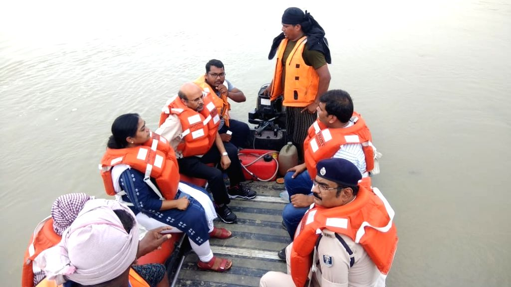 Officials inspect flood situation in Bihar's Katihar on July 18, 2019.