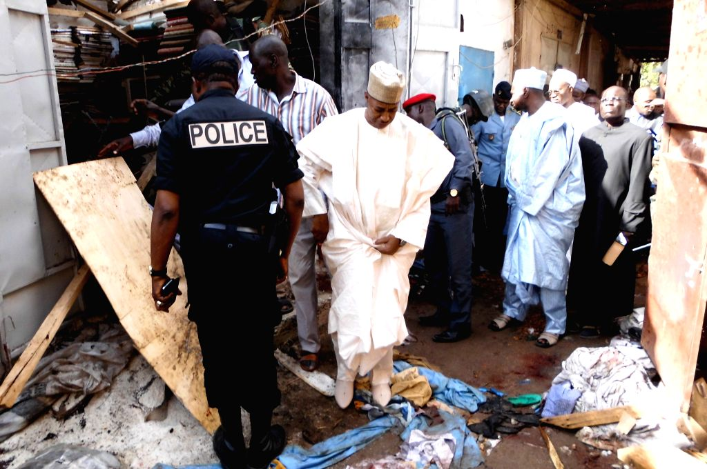 Officials inspect on the blast site in Cameroon's northern city of Maroua on July 22, 2015. An estimated 20 people were killed and more than 30 others injured as ...