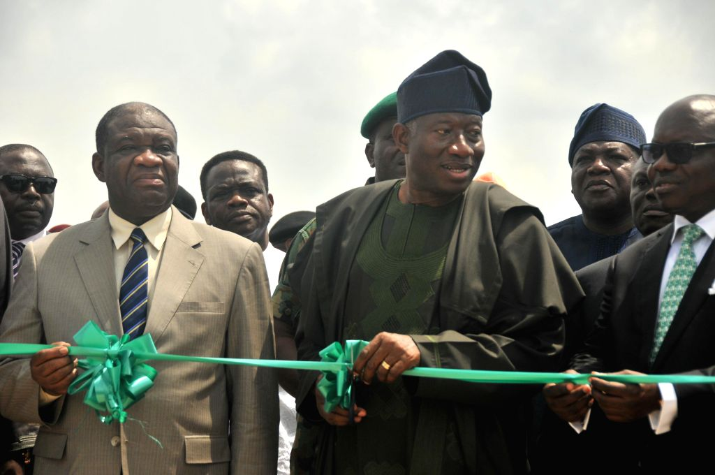 Nigerian President Goodluck Jonathan (C) attends the inauguration ceremony of the 750 megawatt power station in the southwestern Ogun state, Nigeria, on Feb. 20, 2015. ...