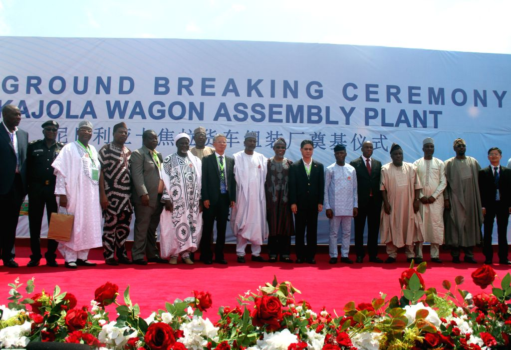 OGUN, Nov. 10, 2019 - Honored guests pose for a group photo at the groundbreaking ceremony for the country's first rolling stock assembly plant in Kajola, Ogun state, Nigeria, Nov. 9, 2019. Chinese ... - Kajol