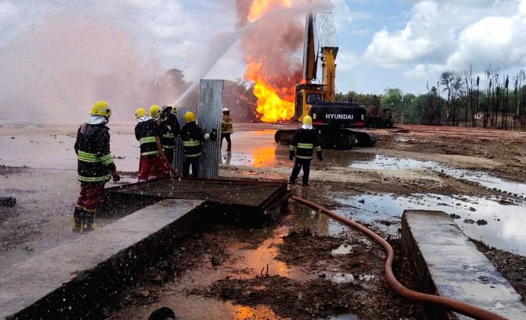 Oil India Limited (OIL) workers engaged in operations to put out the fire and cap the leaking oil well in Baghjan in Tinsukia district of Assam on July 3, 2020. A massive fire broke out on ...