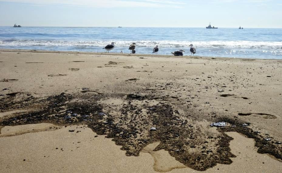 Oil stains the Huntington Beach in Orange County, California, Oct. 3, 2021.