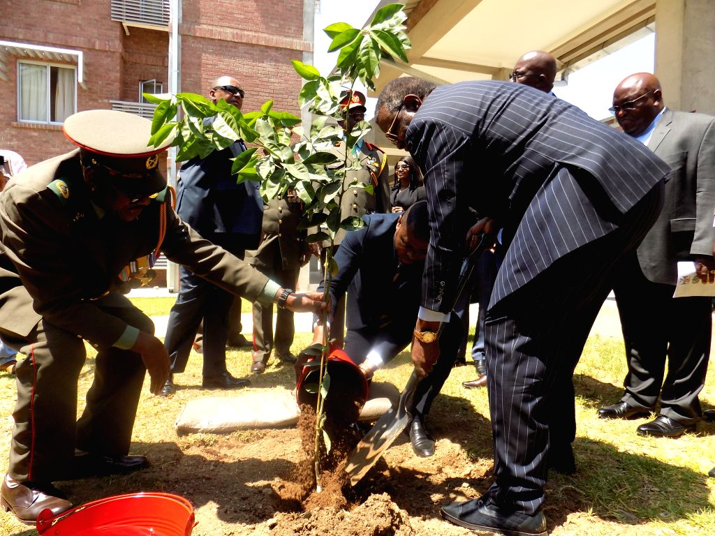 OKAHANDJA (NAMIBIA), Oct. 17, 2019 Namibian President Hage Geingob (1st R, front) plants a tree at the Chinese-funded Namibia Command and Staff College in Okahandja, Namibia, on Oct. 17, ...