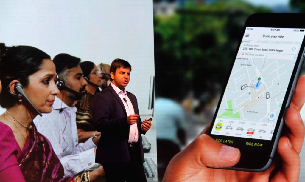 Ola's co-founder and CEO Bhavish Aggarwal addresses during the launch of the world's first connected car platform for ride sharing by Ola in Bengaluru on Nov 22, 2016.
