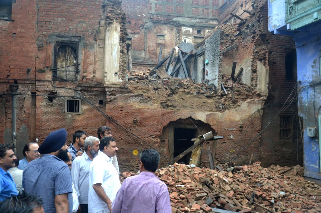 Old building collapsed at the old city area of Amritsar following heavy rain on August 16, 2013. (Photo::: IANS)
