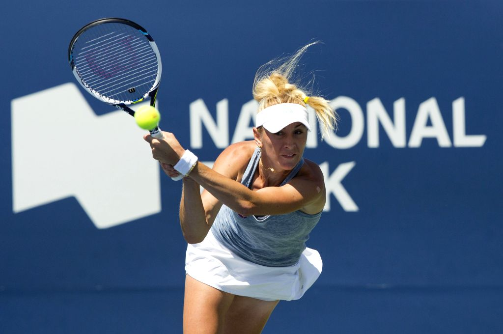 Olga Govortsova of Belarus hits a return during the women's singles 2nd round match against Ana Ivanovic of Serbia at the 2015 Rogers Cup in Toronto, Canada, on ...
