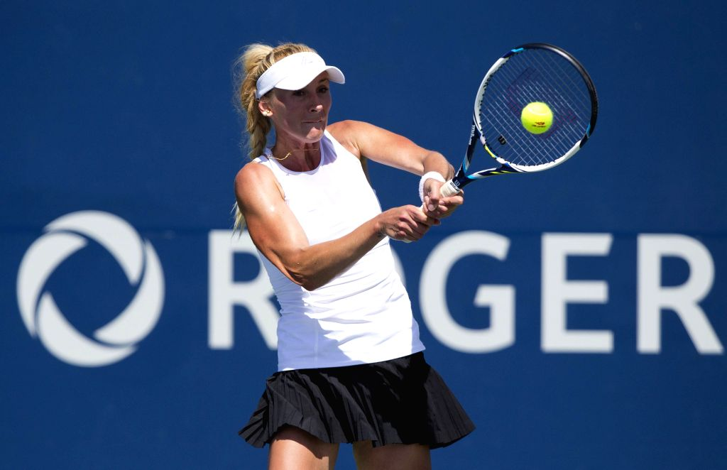 Olga Govortsova of Belarus returns the ball against Julia Glushko of Israel during the second round of women's singles qualifying match at the 2015 Rogers Cup in ...