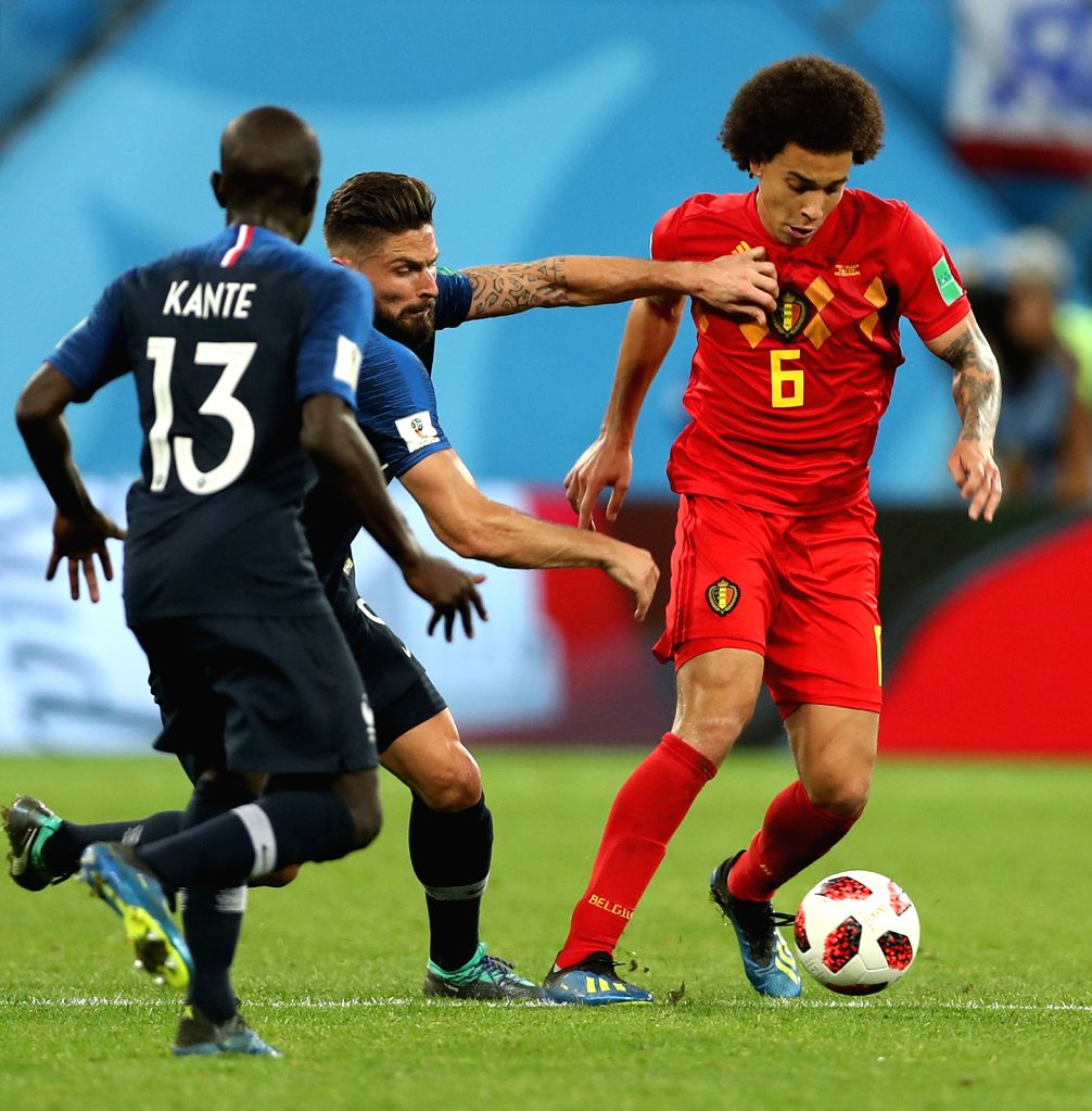 Olivier Giroud (C) of France vies with Axel Witsel (R) of Belgium during the 2018 FIFA World Cup semi-final match between France and Belgium in Saint ...