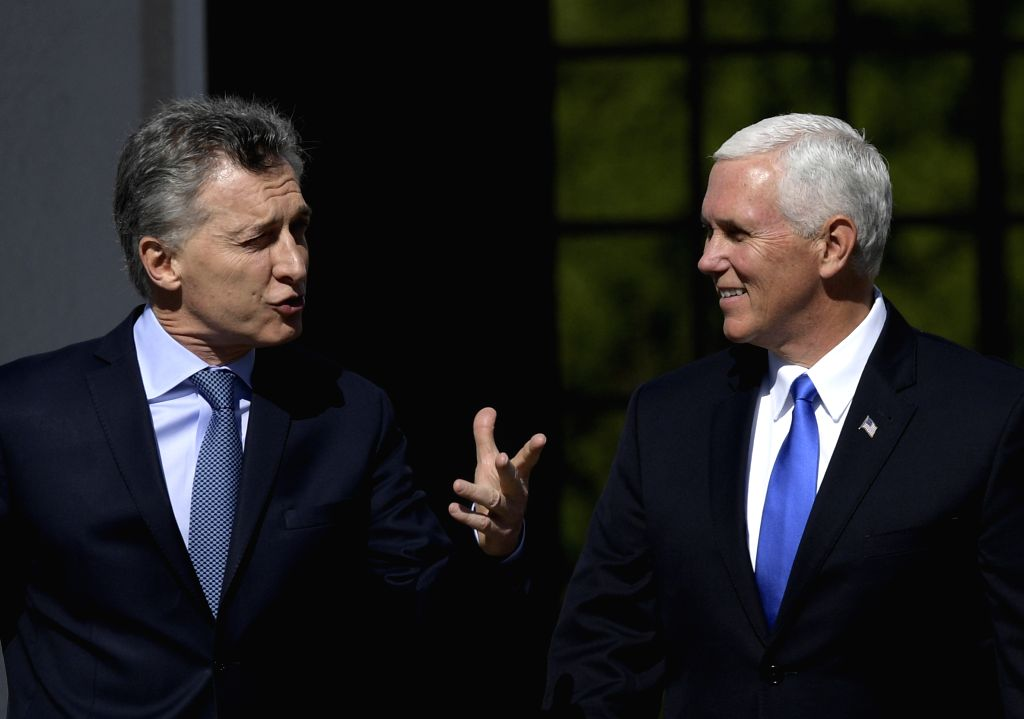 OLIVOS, Aug. 16, 2017 - Argentina's President Mauricio Macri (L) talks with visiting U.S. Vice President Mike Pence at the presidential residence of Quinta de Olivos in the city of Olivos, Argentina, ...
