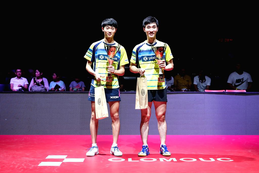 OLOMOUC, Aug. 25, 2019 - Cho Daeseong(L)/Lee Sangsu of South Korea pose for photos during the award ceremony of the men's doubles final match against Liao Cheng-Ting/Lin Yun-Ju of Chinese Taipei at ...