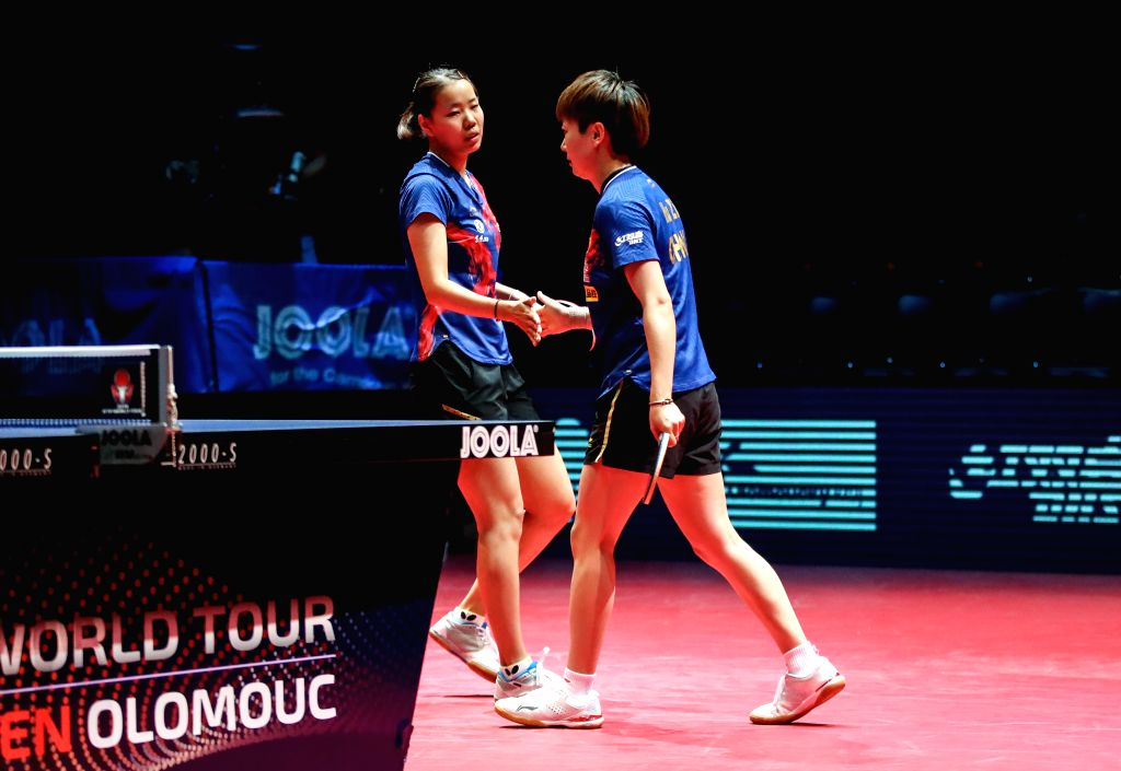 OLOMOUC, Aug. 25, 2019 - Gu Yuting (L)/Mu Zi of China celebrate victory after the women's doubles final match against Miu Hirano/Saki Shibata of Japan during the 2019 ITTF Czech Open in Olomouc, the ...