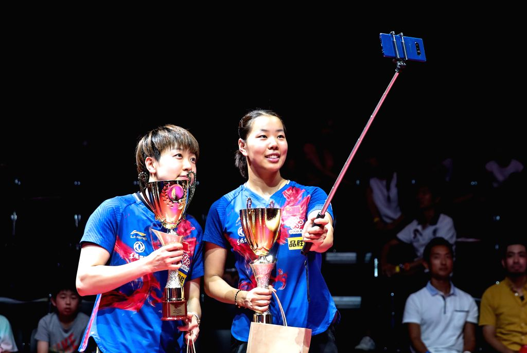 OLOMOUC, Aug. 25, 2019 - Gu Yuting (R)/Mu Zi of China take selfie photos during the award ceremony of the women's doubles final match against Miu Hirano/Saki Shibata of Japan during the 2019 ITTF ...