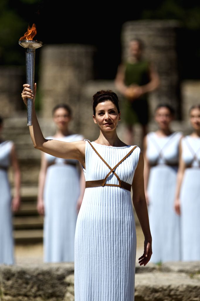 OLYMPIA, April 20, 2016 - Greek actress Katerina Lehou, playing the role of High Priestess, holds up the Olympic flame during a dress rehearsal for the flame lighting ceremony of the Rio 2016 Olympic ... - Katerina Lehou