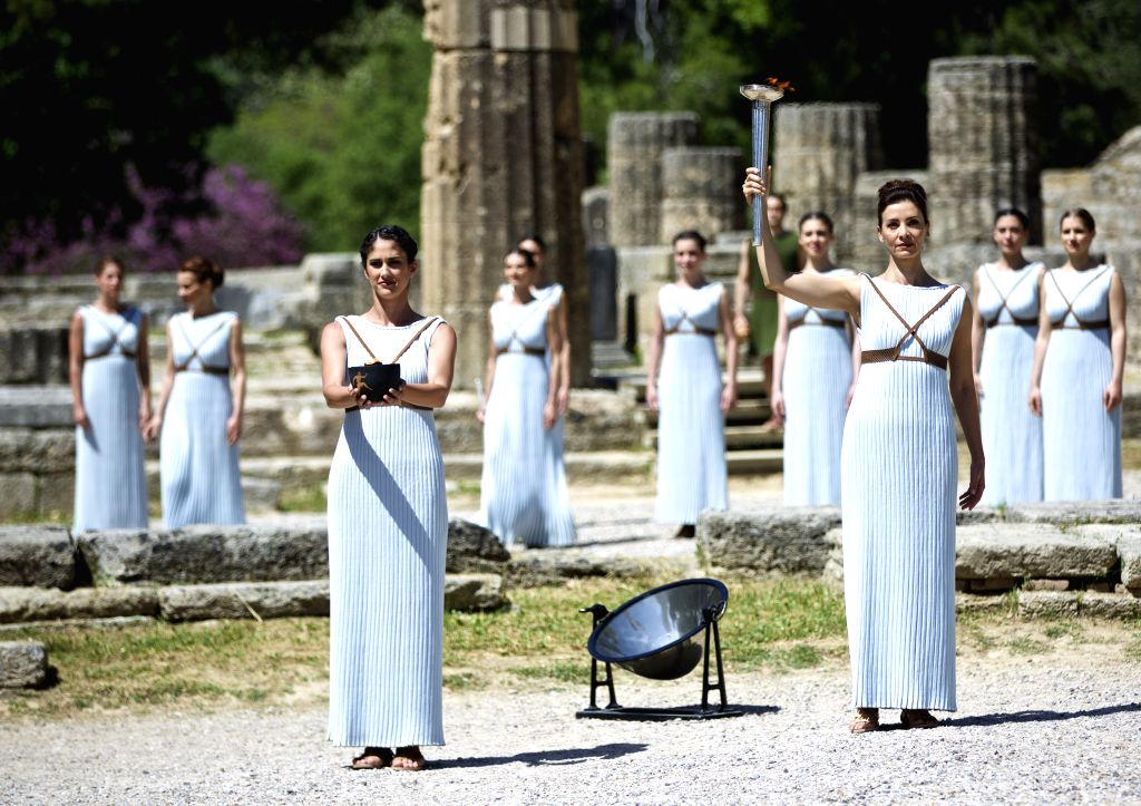 OLYMPIA, April 20, 2016 - Greek actress Katerina Lehou(R), playing the role of High Priestess, lights a cauldron with the Olympic Flame during a dress rehearsal for the flame lighting ceremony of the ... - Katerina Lehou