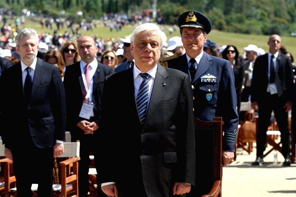 OLYMPIA, April 21, 2016 - Greek President Prokopis Pavlopoulos (Front) attends the Olympic flame lighting ceremony for the Rio 2016 Olympic Games in the ancient Olympic Stadium on the site of ancient ...