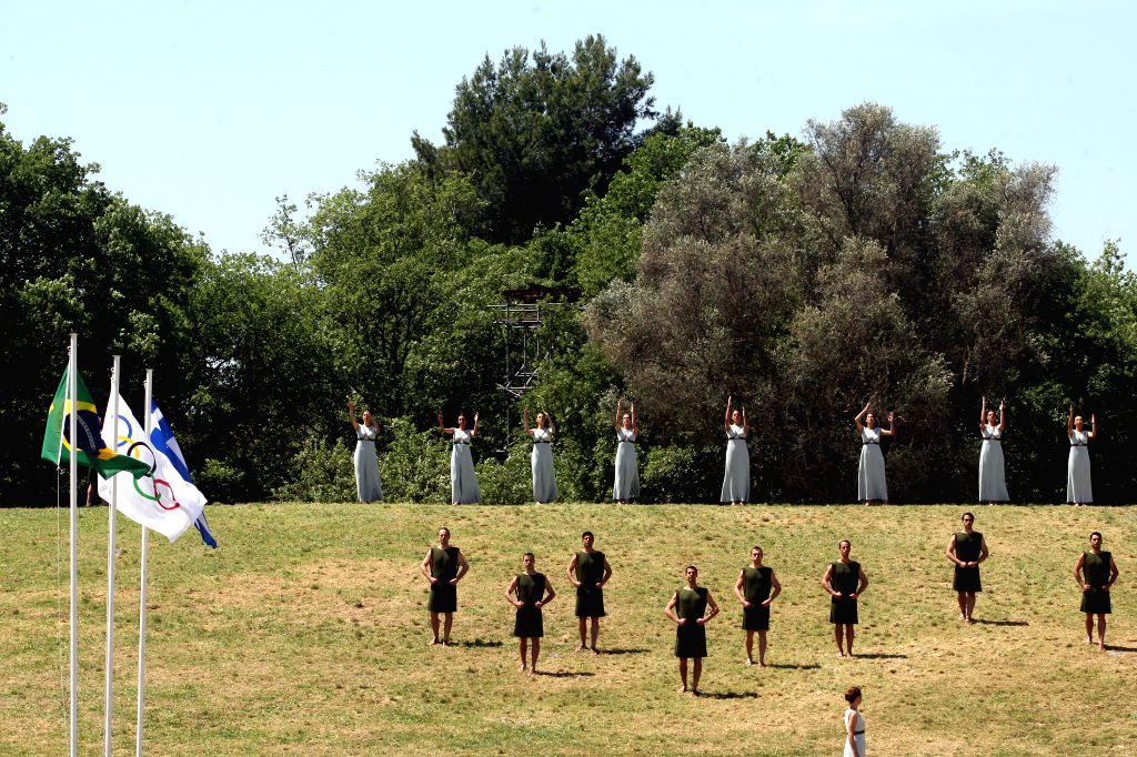 OLYMPIA, April 21, 2016 - Priestesses and dancers attend the Olympic flame lighting ceremony for the Rio 2016 Olympic Games in the ancient Olympic Stadium on the site of ancient Olympia, Greece, ...