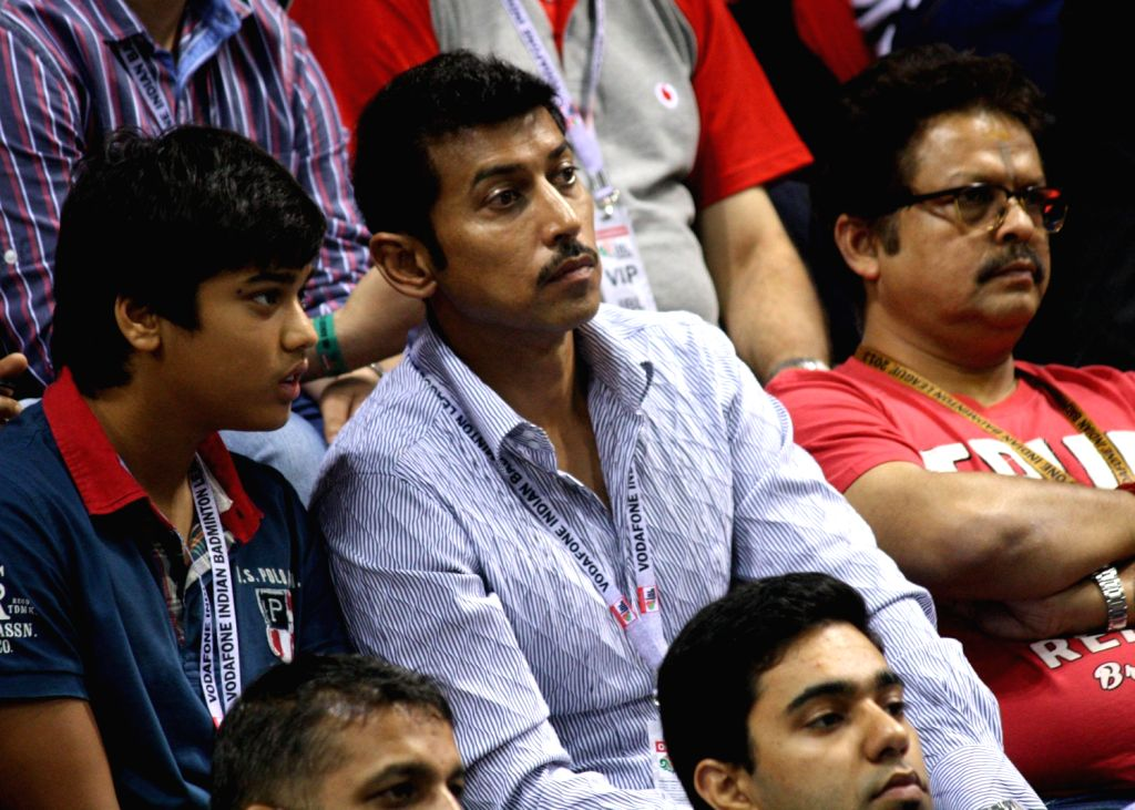 Olympics silver medallist shooter Rajyavardhan Singh Rathore at the stands during the Indian Badminton League in New Delhi on August 15, 2013. (Photo::: IANS) - Rajyavardhan Singh Rathore
