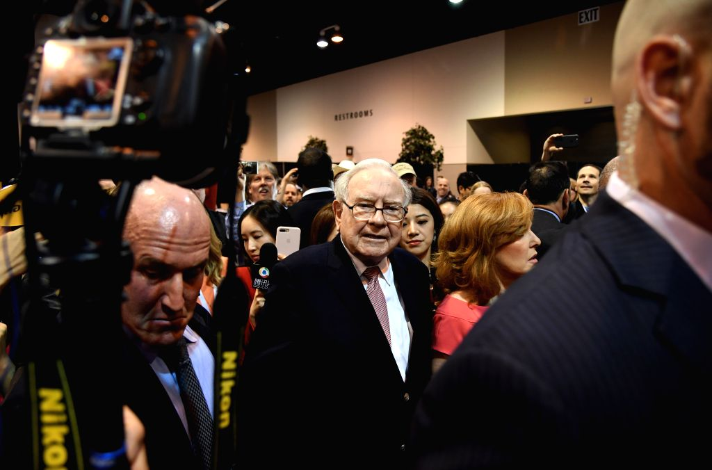 OMAHA, May 7, 2017 - Warren Buffett, chairman and chief executive officer of Berkshire Hathaway speaks to media when viewing an exhibtion of goods he invested during the annual meeting in Omaha, ...