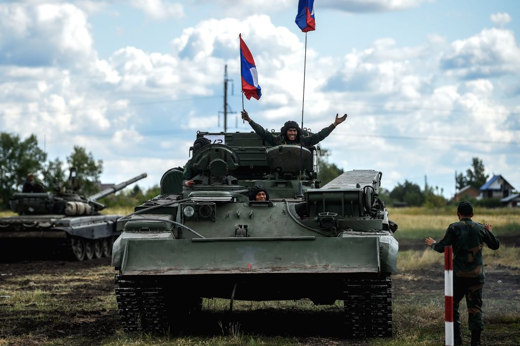 "OMSK (RUSSIA), Aug. 9, 2019 A soldier of Laos waves a flag during the ""Maintenance Battalion"" contest during the International Army games 2019 in Omsk, Russia, on Aug. 9, 2019. ..."