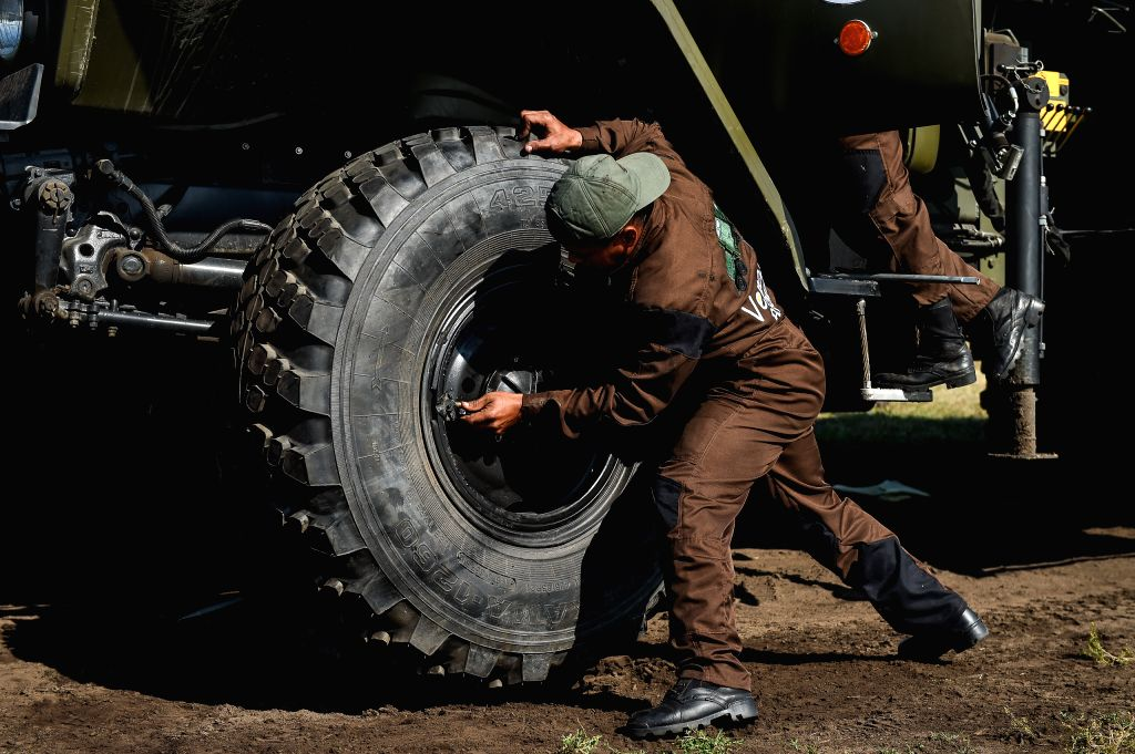 "OMSK (RUSSIA), Aug. 9, 2019 Team of Venezuela competes during the ""Maintenance Battalion"" contest during the International Army games 2019 in Omsk, Russia, on Aug. 9, 2019. The ..."