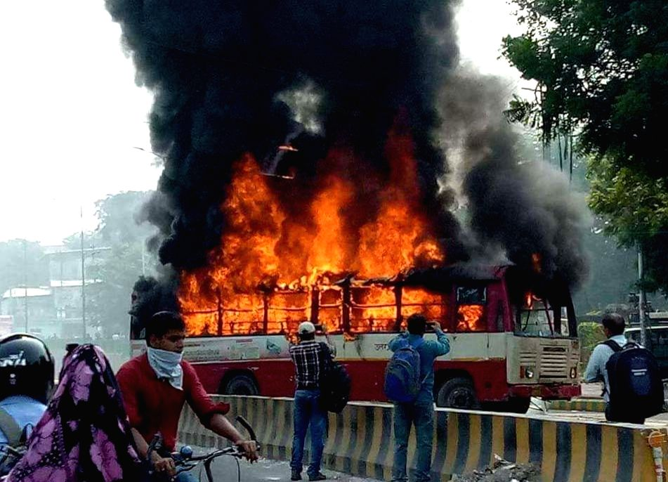 On of the buses set ablaze after Rajesh Yadav, a leader of the Bahujan Samaj Party (BSP) was shot dead in Allahabad on Oct 3, 2017. - Rajesh Yadav