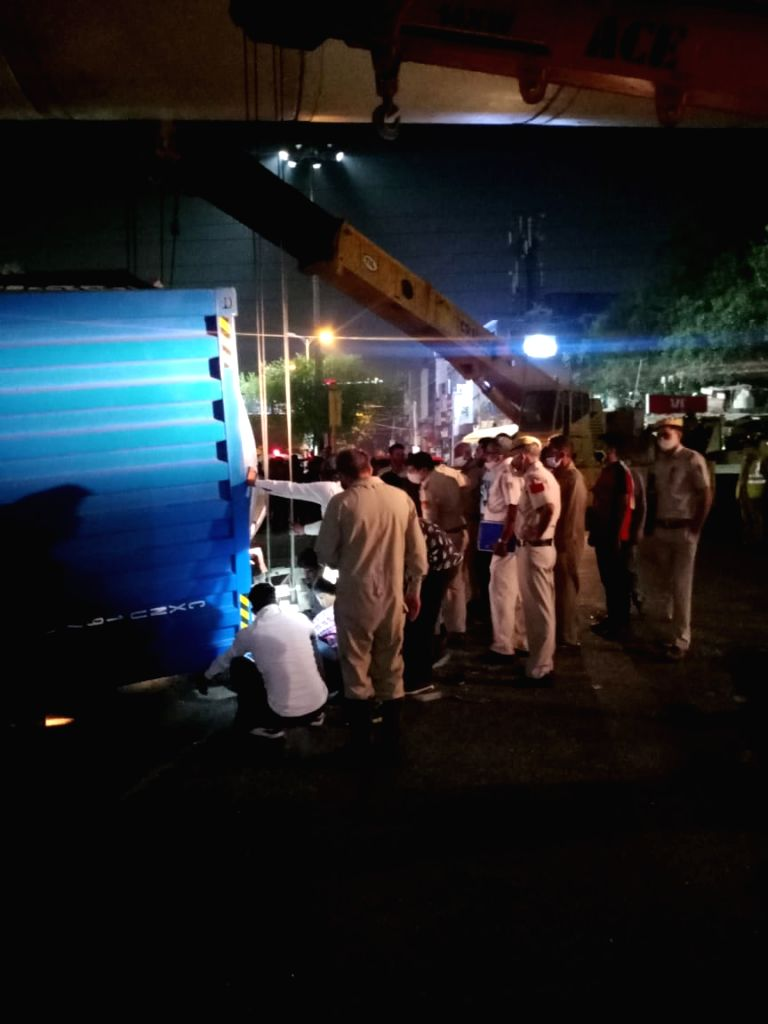 On the way to Airport 2 crushed to death as Truck overturns on car in Lajpat Nagar.