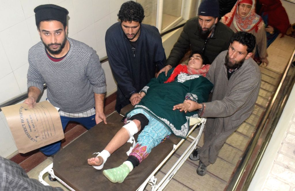 One of the 28 students who were injured in a mysterious explosion inside a tuition centre in Jammu and Kashmir's Pulwama district being taken to Pulwama district hospital  for treatment on ...