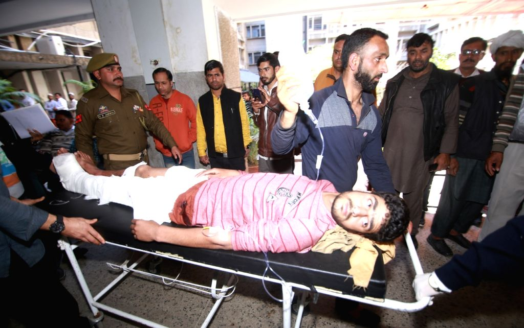 One of the 30 persons inured in Jammu bus stand grenade attack being wheeled into a Jammu hospital for treatment on March 7, 2019. One person was killed when a grenade was rolled under a ...