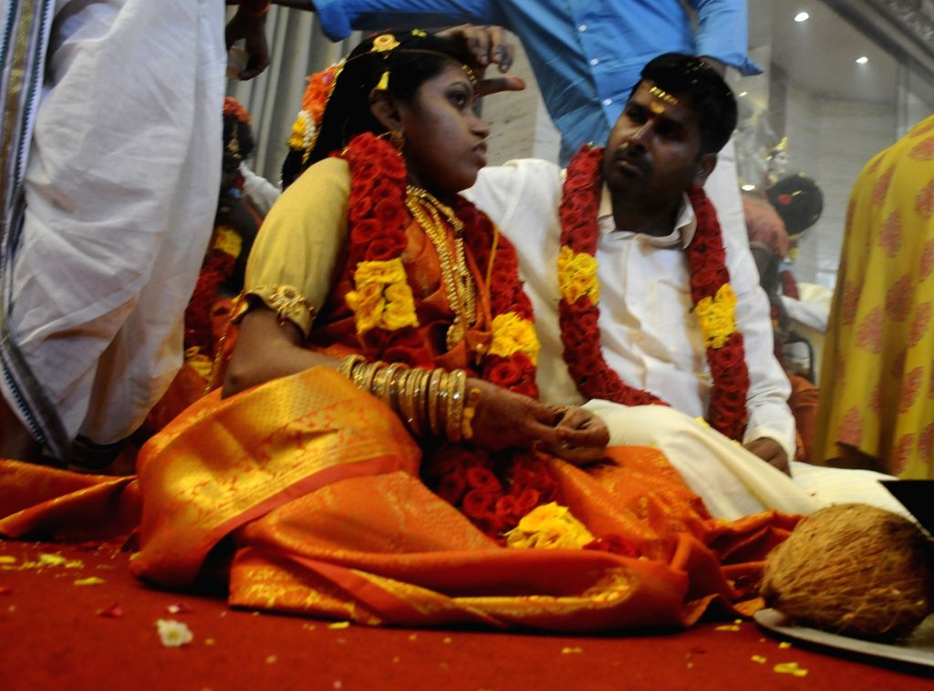 One of the 48 differently-abled couples who participated in a mass wedding jointly organised by Shree Geeta Bhavan Trust and Tamil Nadu Differently Abled Federation Charitable Trust for ...