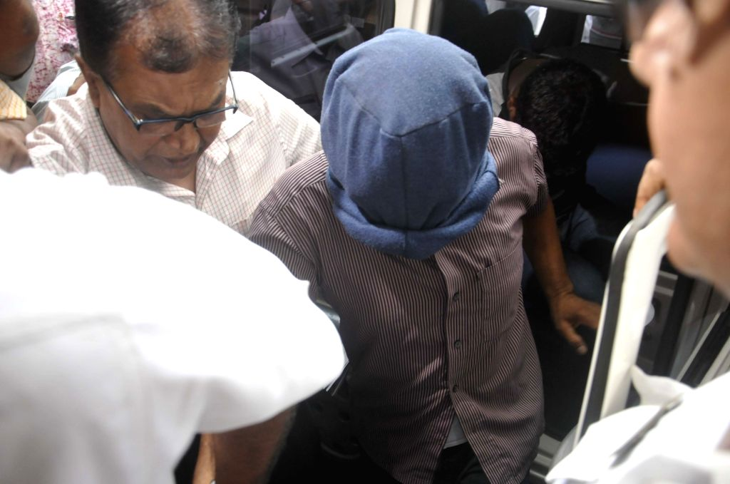 One of the alleged conspirators of the 2002 terror attack on American Center in Kolkata being taken away to be produced before a Kolkata court on Oct 4, 2016.