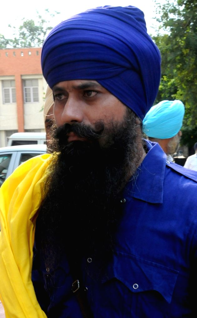 One of the four Khalistan Zindabad Force (KZF) terrorists being taken to be produced before the Court of Judicial Magistrate in Amritsar on Sep 23, 2019. The four terrorists identified as ... - Balwant Singh, Aakashdeep Singh, Harbhajan Singh and Balveer Singh