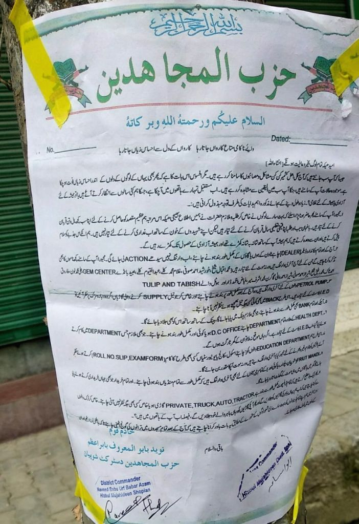 One of the frequently put up posters of Hizbul Mujahideen appears in town areas of Shopian. A direct warning to government employees, Apple traders, transporters etc.