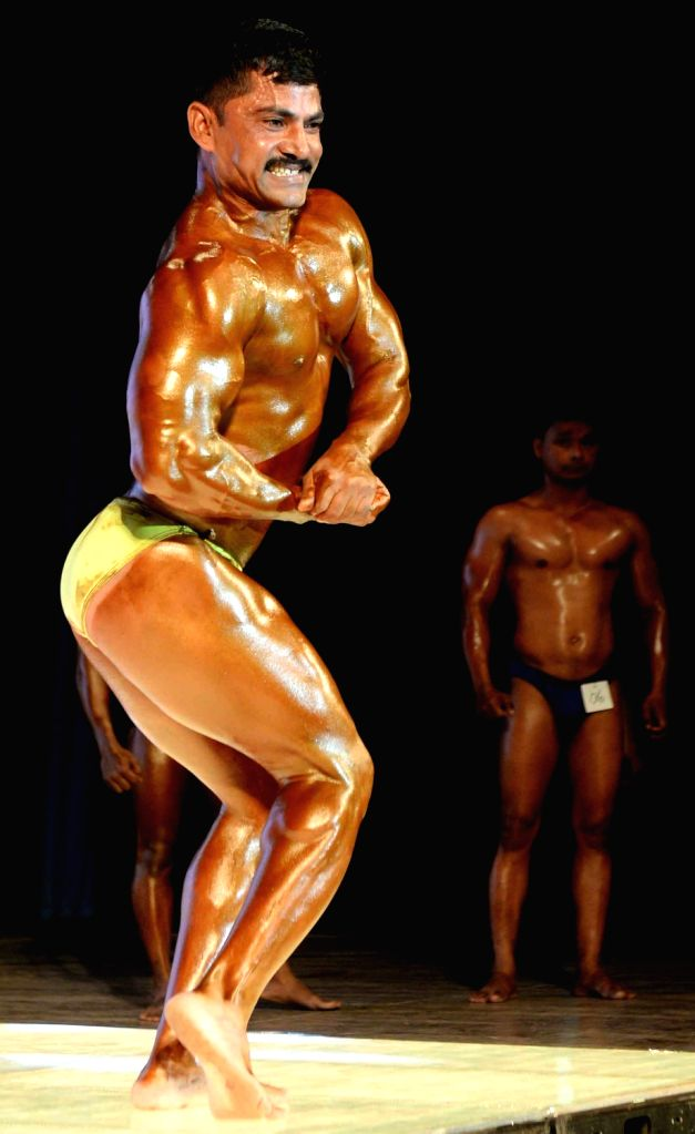 One of the participants of 65th National Body Building Championship strikes a pose in Bengaluru on May 13, 2017.