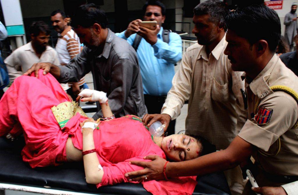 One of the passengers who got injured when a vehicle in which she was travelling in fell into a deep gorge in Jammu and Kashmir's Reasi district, being rushed for treatment in Jammu on Aug 9, ...